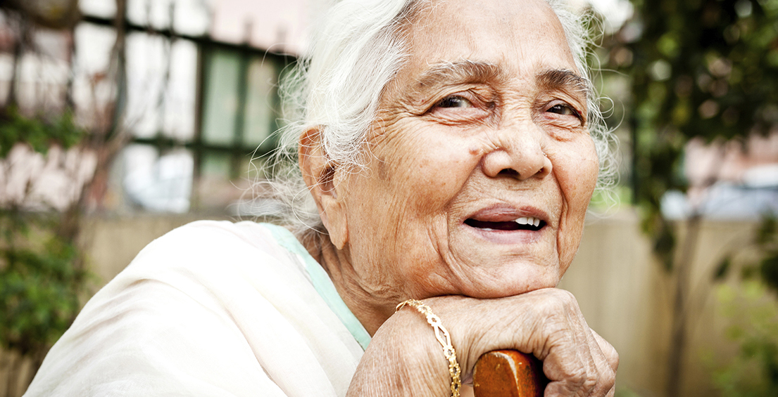 One cheerful senior Indian woman
