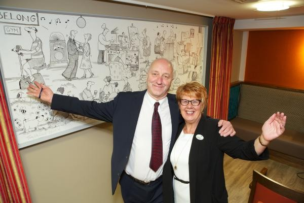 Award winning cartoonist, Tony Husband, unveils his mural at the Belong Warrington opening ceremony.